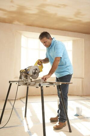 Builder Using Electric Saw photo