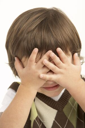 Studio Portrait Of Young Boy Covering Eyes Stock Photo - 6452631