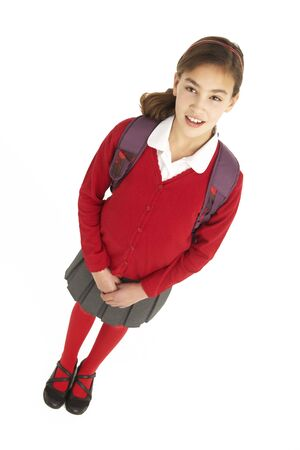 11 year old girl: Studio Portrait Of Female Student In Uniform With Backpack