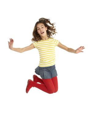 11 year old girl: Mid Air Studio Shot Of Young Girl Jumping In Air