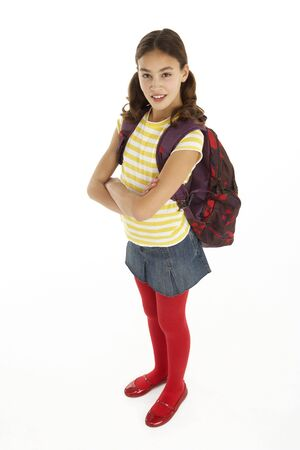Studio Portrait Of Young Girl With Backpack photo