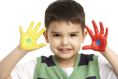 3 year old boy: Studio Portrait Of Young Boy With Painted Hands