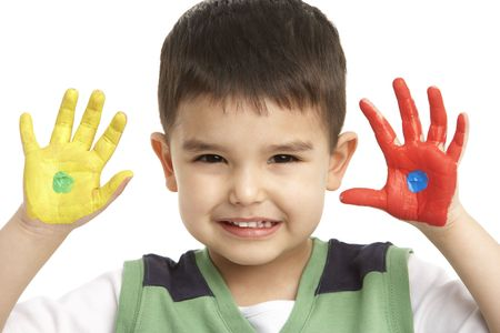 Studio Portrait Of Young Boy With Painted Hands photo