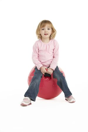 Young Girl Having Fun On Inflatable Hopper photo