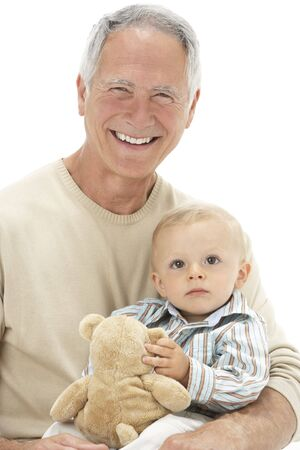 Studio Portrait Of Grandfather Holding Grandson With Teddy Bear photo