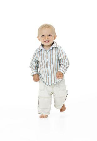 toddler walking: Toddler Walking In Studio Stock Photo