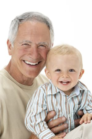Studio Portrait Of Grandfather Holding Grandson photo