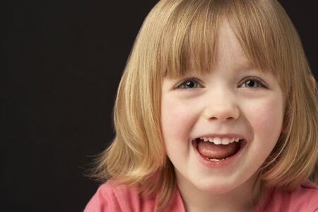 Close Up Studio Portrait Of Smiling Young Girl photo