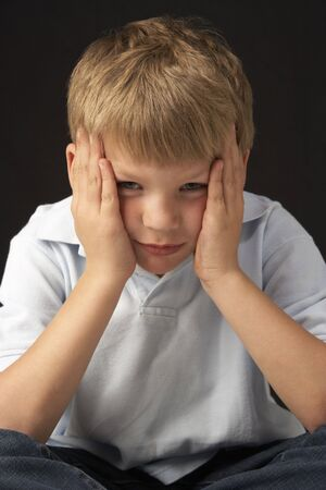 sulk: Studio Portrait Of Worried Boy