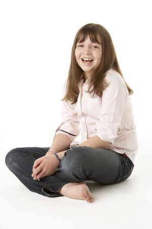 mischievious: Young Girl Sitting In Studio