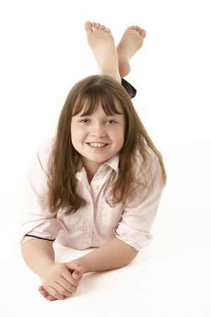 Young Girl Lying On Stomach In Studio Stock Photo - 6451090