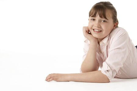 11 year old girl: Young Girl Lying On Stomach In Studio