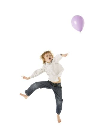 boy 12 year old: Young Boy Jumping With Balloon In Studio