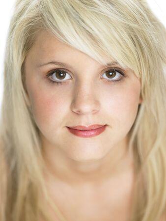Close Studio Portrait Of Blonde Teenage Girl photo