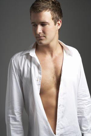 open shirt: Studio Portrait Of Young Man Wearing Open Shirt