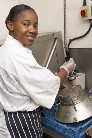 Kitchen Worker Washing Up In Restaurant Kitchen photo
