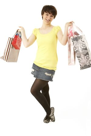 fifteen year old: Studio Portrait Of Teenage Girl Carrying Shopping Bags