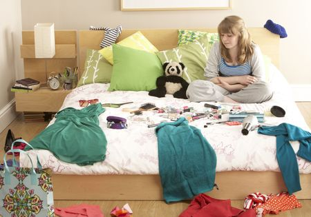 messy clothes: Teenage Girl In Untidy Bedroom