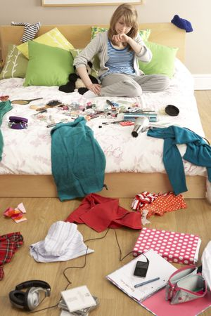 Teenage Girl In Untidy Bedroom photo