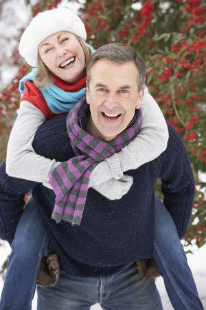 Senior Couple Outside In Snowy Landscape photo