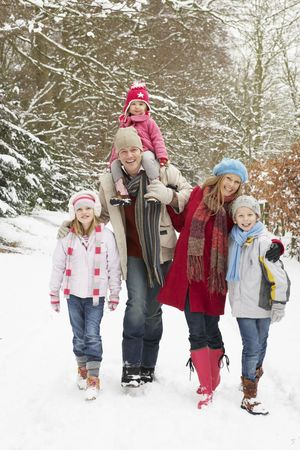 6 7 year old: Family Walking Through Snowy Woodland