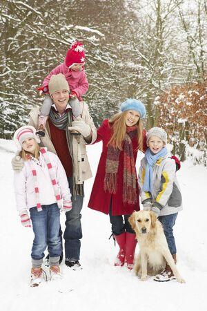 Family Walking Through Snowy Woodland Stock Photo - 6451526