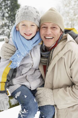 Father And Son Standing Outside In Snowy Landscape Stock Photo - 6451217