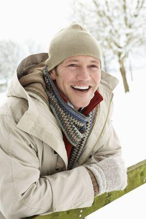 Man Standing Outside In Snowy Landscape photo