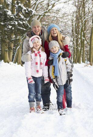 Family Walking Through Snowy Woodland Stock Photo - 6451306