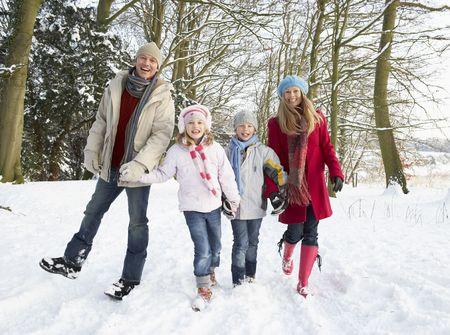 Family Walking Through Snowy Woodland Stock Photo - 6451307