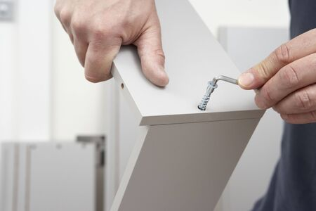 assembly: Close Up Of Man Assembling Flat Pack Furniture