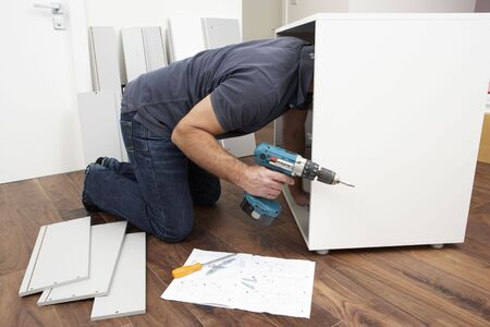 and the horizontal man: Man Assembling Flat Pack Furniture