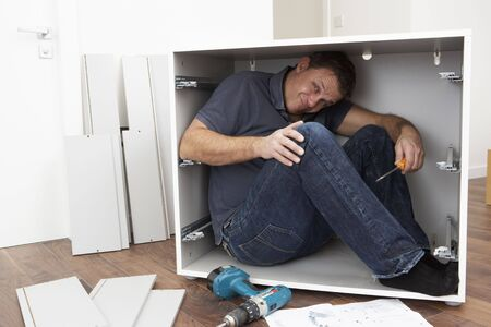 Man Trapped Whilst Assembling Flat Pack Furniture Stock Photo - 6450924