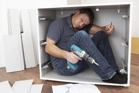 Man Trapped Whilst Assembling Flat Pack Furniture photo