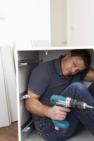 Man Trapped Whilst Assembling Flat Pack Furniture Stock Photo - 6451034