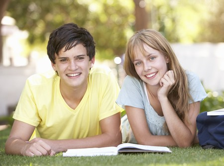 Teenage Student Couple Studying In Park photo
