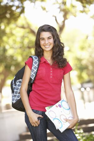 Female Teenage Student In Park Stock Photo - 8108582