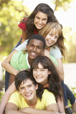 piled: Group Of Teenagers Piled Up In Park Stock Photo