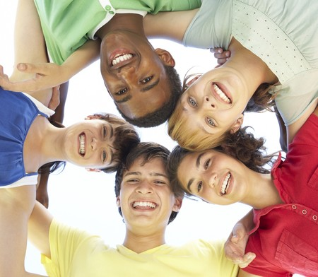 Group Of Teenagers Looking Down Into Camera photo