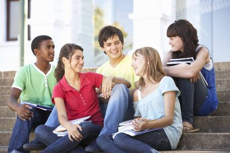 chat group: Group Of Teenage Friends Sitting On College Steps Outside