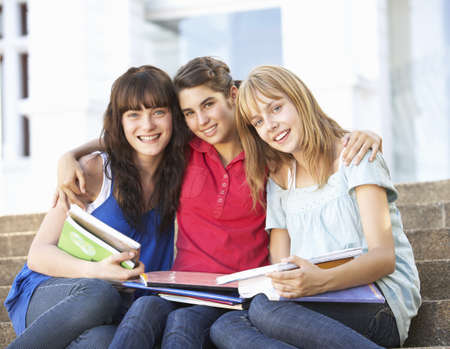 Group Of Teenage Female Friends Sitting On College Steps Outside Stock Photo - 8108671