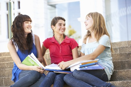 Group Of Teenage Female Friends Sitting On College Steps Outside Stock Photo - 8108673