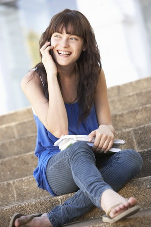 Teenage Student Sitting Outside On College Steps Stock Photo - 8108675