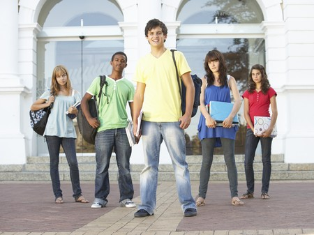Group Of Teenage Students Standing Outside College Building photo