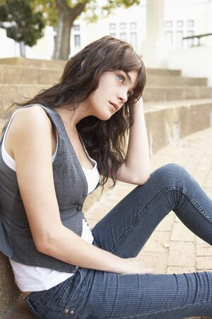 Unhappy Female Teenage Student Sitting Outside On College Steps Using Mobile Phone Stock Photo - 8108732