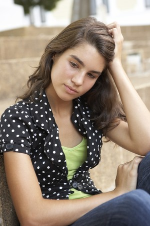 Unhappy Female Teenage Student Sitting Outside On College Steps Using Mobile Phone Stock Photo - 8108698