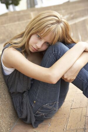 Unhappy Female Teenage Student Sitting Outside On College Steps Using Mobile Phone Stock Photo - 8108717