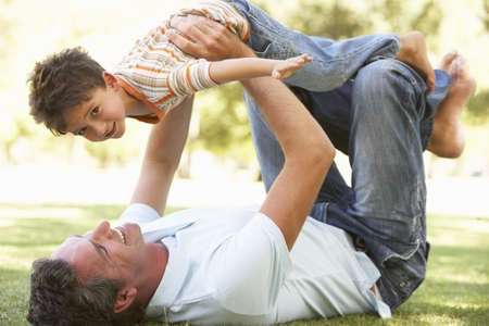 Father And Son Playing Together In Park photo