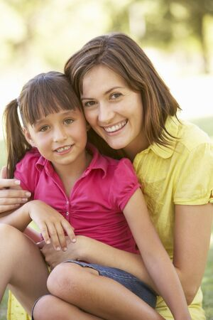 Portrait Of Mother And Daughter Together In Park photo