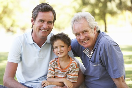 sons and grandsons: Grandfather With Father And Son In Park Stock Photo